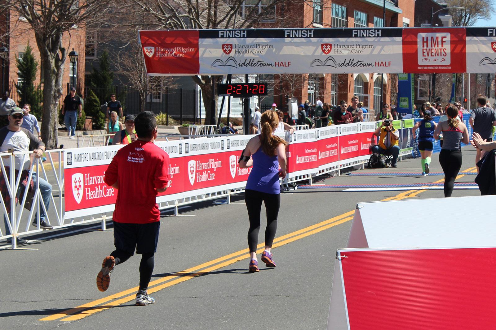 runners across finish line