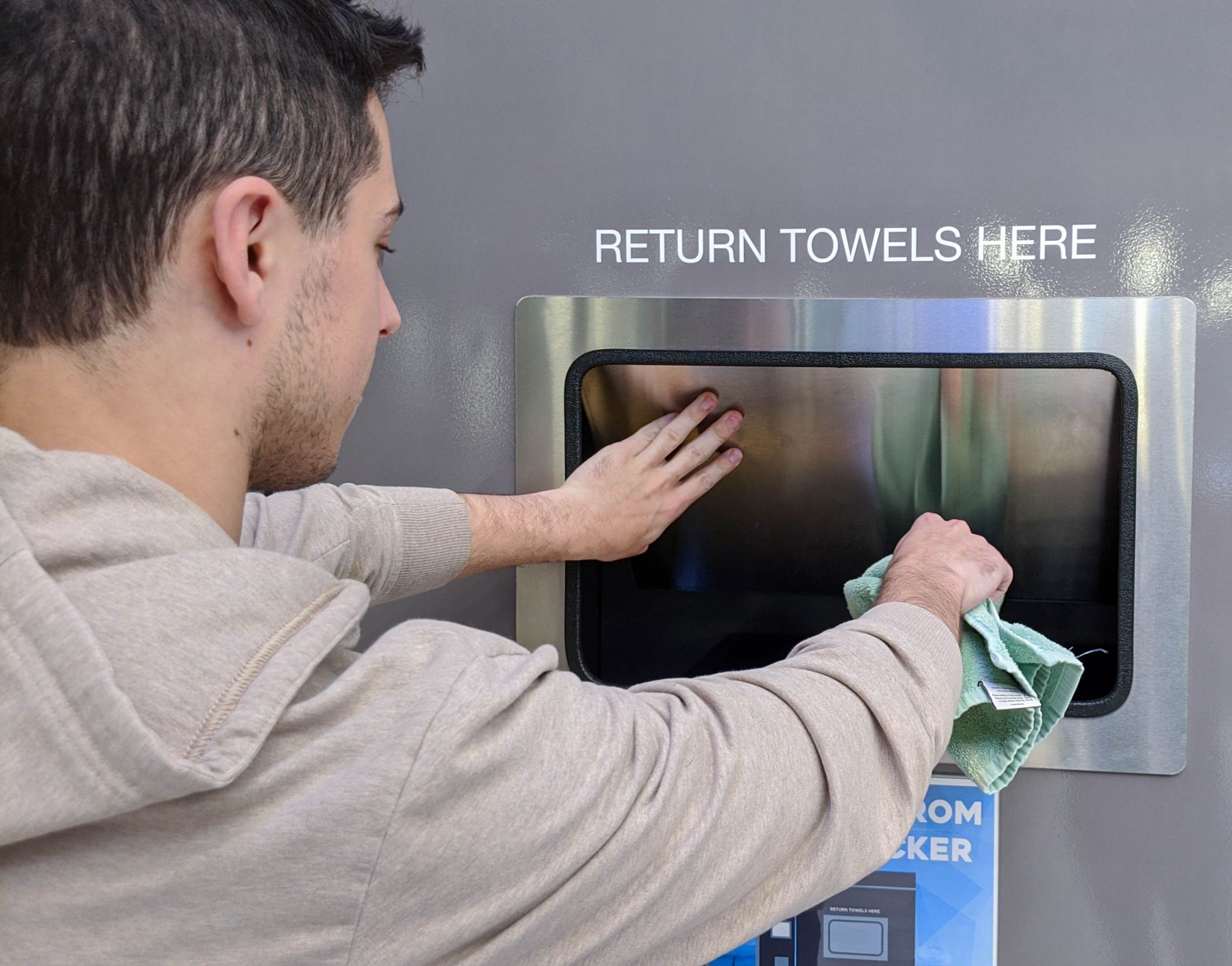Returning towel to Towel Tracker Kiosk